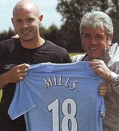 mills signs 2004 to 05
