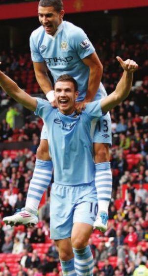 man utd away 2011 to 12 dzeko celebrates both goals